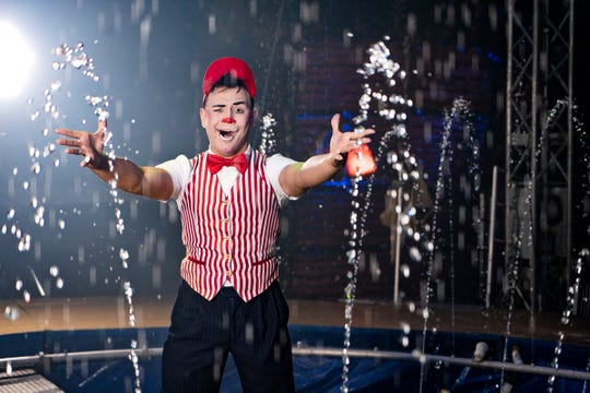 Rafael Salguiero performs his clowning routine on the water stage of Cirque Italia.