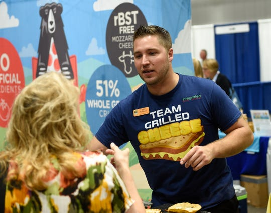 Billy Rosenthal, Midwest Regional Sales Manager at Integrated Food Service, showcases the company's new creations Tuesday, Aug. 6, 2019, during the state conference of the Minnesota School Nutrition Association at River's Edge Convention Center.