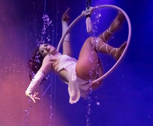 Samantha Kulinski performs an aerial hoop routine during a Cirque Italia performance.