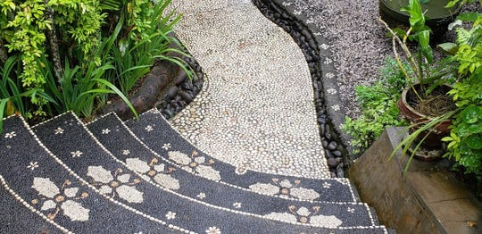 This pebble mosaic pathway in Bali, Indonesia is very artistic.