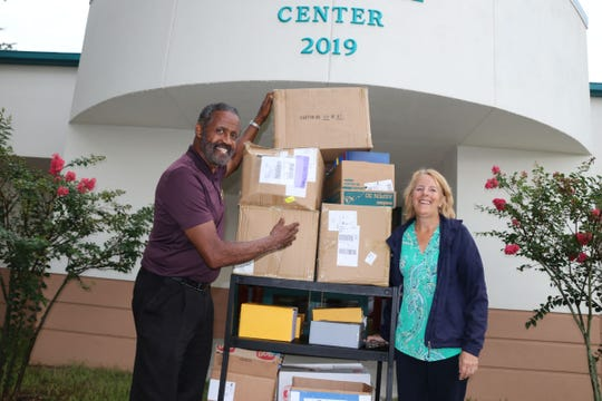 Gifford Youth Achievement Center's Freddie Woolfork receives a big donation of supplies from Disney's Vero Beach Resort.