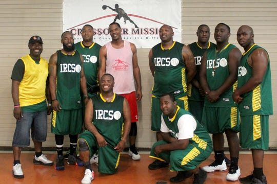Antoine Jennings, center, Crossover Mission co-founder and coach, with members of the Sheriff's Office team.