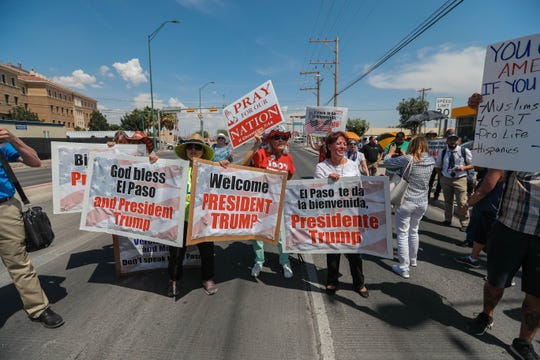 Protesters and counter-protesters gather to see President Trump's motorcade in El Paso on Wednesday, Aug. 7, 2019.