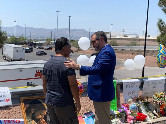 U.S. Sen. Ted Cruz, R-Texas, visits a makeshift memorial on Wednesday, Aug. 7, 2019, near a Walmart in El Paso where 22 were killed and dozens more injured.