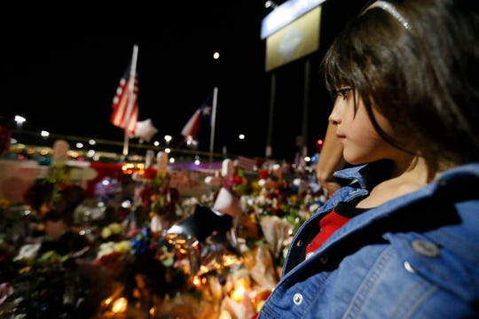Kimberly Prieto looks at the vigil outside Walmart Tuesday, Aug. 6, in El Paso.