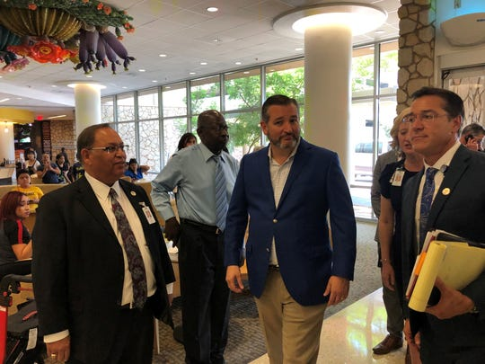 Jacob Cintron, University Medical Center of El Paso chief executive officer, left,  meets U.S. Sen. Ted Cruz, R-Texas, middle, when Cruz came to the hospital Aug. 7, 2019, to visit survivors of the Aug. 3 Walmart mass shooting.
