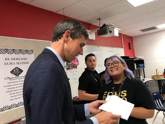 Presidential candidate Beto O'Rourke attends a memorial for the 22 people killed in a shooting at an El Paso Walmart. The memorial was held at El Dorado High School in El Paso on Aug. 7, 2019.