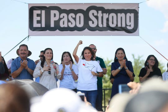 U.S. Rep. Veronica Escobar, D-El Paso, cheers with attendees at the El Paso Strong rally Wednesday, Aug. 7, at Washington Park in El Paso. President Donald Trump visited El Paso.