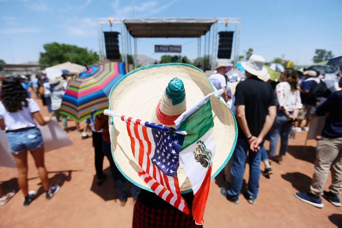 Protesters gather in Washington Park before President Donald Trump's  arrival in El Paso.