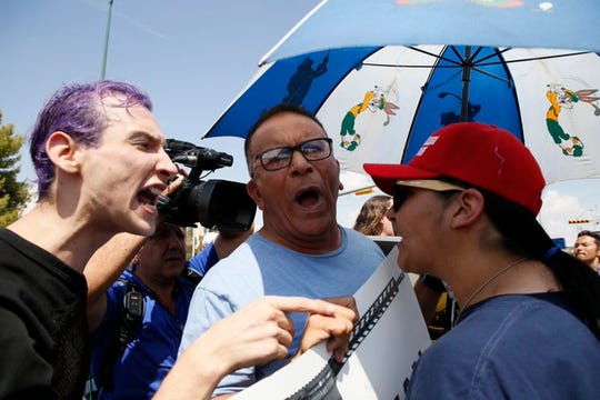 There was a silence among Donald Trump supporters and El Pasoans angered by his visit today. The heat and political tension boiled over into several arguments along a narrow spit of sidewalk near UMC hospital where Trump is visiting.
