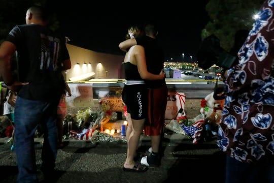 Vigil outside Walmart in El Paso continues Tuesday, Aug. 6, in El Paso.