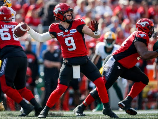 Calgary Stampeders quarterback Nick Arbuckle gets set to throw the ball during first half against the Edmonton Eskimos in a CFL game on Saturday. The St. Bonaventure High graduate completed 19 of 28 passes for 189 yards and a touchdown in a 24-18 victory.