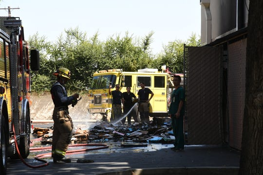 Firefighters responded to a box fire at Visalia's Walgreens Pharmacy on Court Street and Walnut Avenue on Aug. 7, 2019.