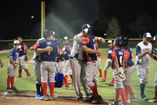 Players hug it out after the Guam U12 All-Stars lost 6-2 to Visalia Grey at the 2019 Cal Ripken Major 60 World Series Aug. 6 in Visalia, California. Go to www.GuamPDN.com for more photos.