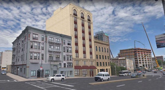 A rendering of a mixed-use building that's set to be constructed at 9-11 Riverdale Avenue.