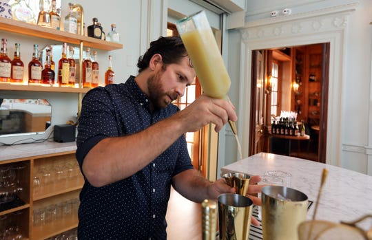 General Manager Carlos Baz mixes a drink at Goosefeather in Tarrytown Aug. 6, 2019.