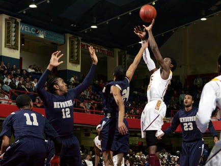 Mount Vernon's Jabarie Hinds (55) goes up for a shot against Newburgh during the boys class AA regional at the Westchester County Center in White Plains March 8, 2011. Mount Vernon won the game 72-49.