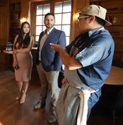 Vinnie and Nutcha Caiola listen as chef Dale Talde talks about his new restaurant, Goosefeather in Tarrytown Aug. 6, 2019.
