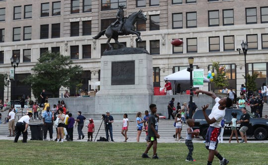 People mingle police, fire and other public service agencies during the National Night Out events on Wilmington's Rodney Square Tuesday.
