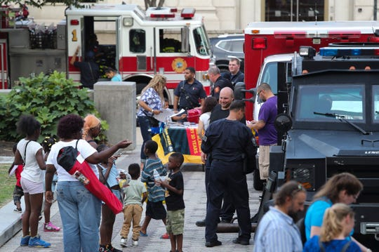 Wilmington police and fire department members are among the public service agencies greeting visitors during the National Night Out events on Wilmington's Rodney Square Tuesday.