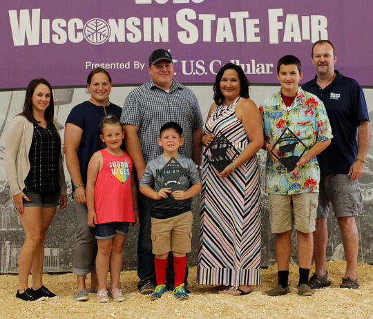 Tina Kohlman (center) of Plymouth was inducted into the 2019 Dairy Barn Hall of Fame for her 19 years of service on the Wisconsin State Fair Jr. Dairy Staff, 9 of those year serving as superintendent.