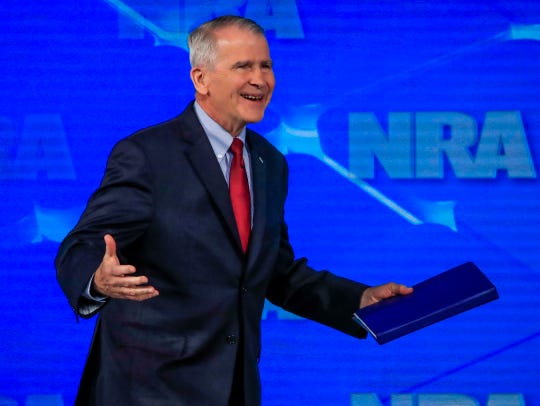 Lt. Col. Oliver North, then president of the NRA, arrives to speak at the group's 2019 annual Leadership Forum at Lucas Oil Stadium in Indianapolis on April 26, 2019.
