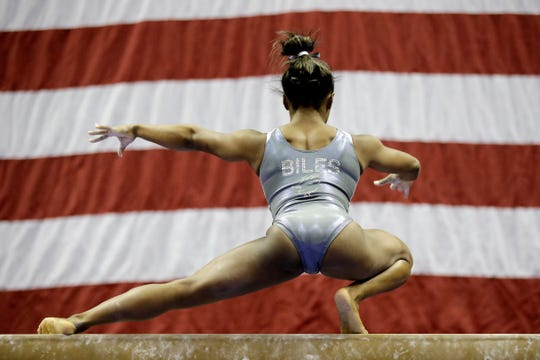 Simone Biles works on the beam during practice for the U.S. Gymnastics Championships Wednesday. Besides her name, the back of her leotard has a picture of a goat, as in G.O.A.T.