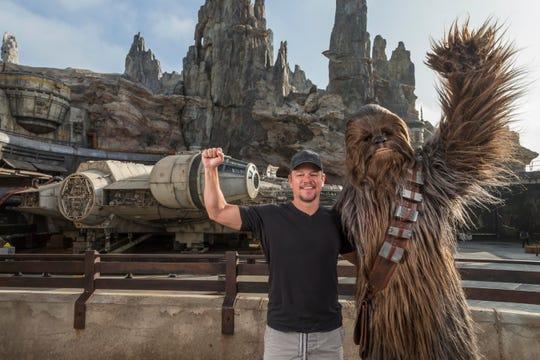 Matt Damon encounters Chewbacca at the new Star Wars: Galaxy's Edge at Disneyland Park in Anaheim, Calif., Aug. 5, 2019.
