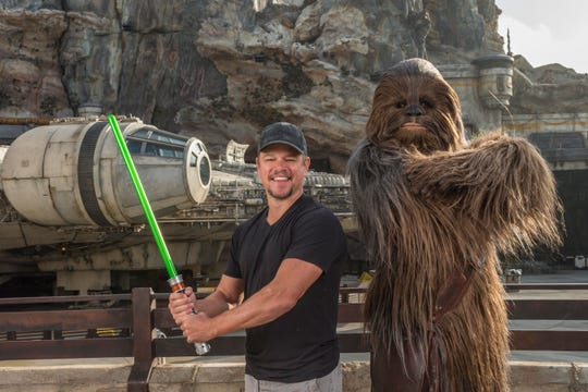Matt Damon meets Chewbacca in front of Millennium Falcon: Smugglers Run before taking the controls of the ride.