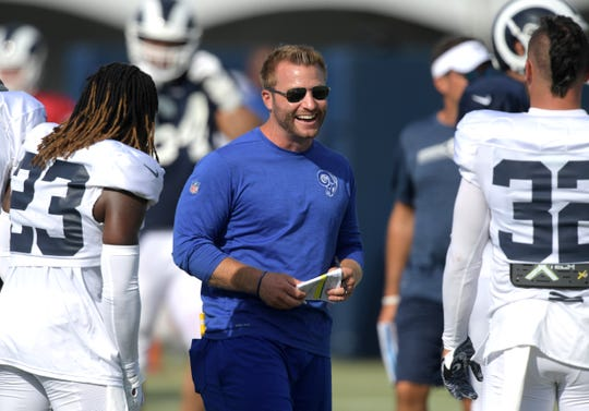 Los Angeles Rams coach Sean McVay (center) talks with cornerback Nickell Robey-Coleman (23) and safety Eric Weddle (32) during training camp at UC Irvine.
