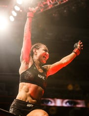 Cris Cyborg celebrates the win over Felicia Spencer at UFC 240, in Edmonton, Alberta.