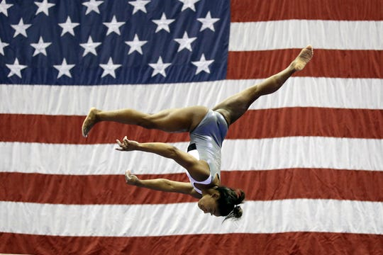 Simone Biles works on the beam during practice for the U.S. Gymnastics Championships on Aug. 7, 2019, in Kansas City, Mo. (AP Photo/Charlie Riedel)