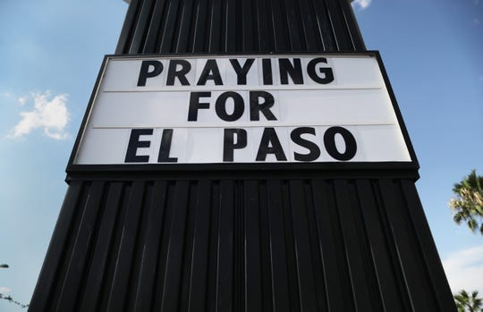 A hotel billboard reads 'Praying For El Paso' not far from the scene of a mass shooting which left at least 22 people dead on Aug. 6, 2019 in El Paso, Texas.  A 21-year-old white male suspect remains in custody in El Paso which sits along the U.S.-Mexico border. President Donald Trump plans to visit the city August 7.
