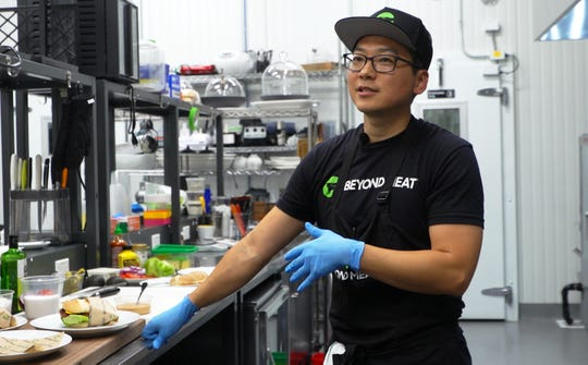 Chef Seong Hwang prepares beyond burgers inside of Beyond Meat headquarters in Los Angeles, Calif. on July 26, 2019. Since becoming Chris Paul's chef, he has shifted his diet to be almost completely plant-based.