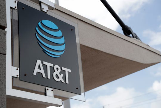 In this Thursday, July 18, 2019 photo, is an AT&T retail store in Miami.