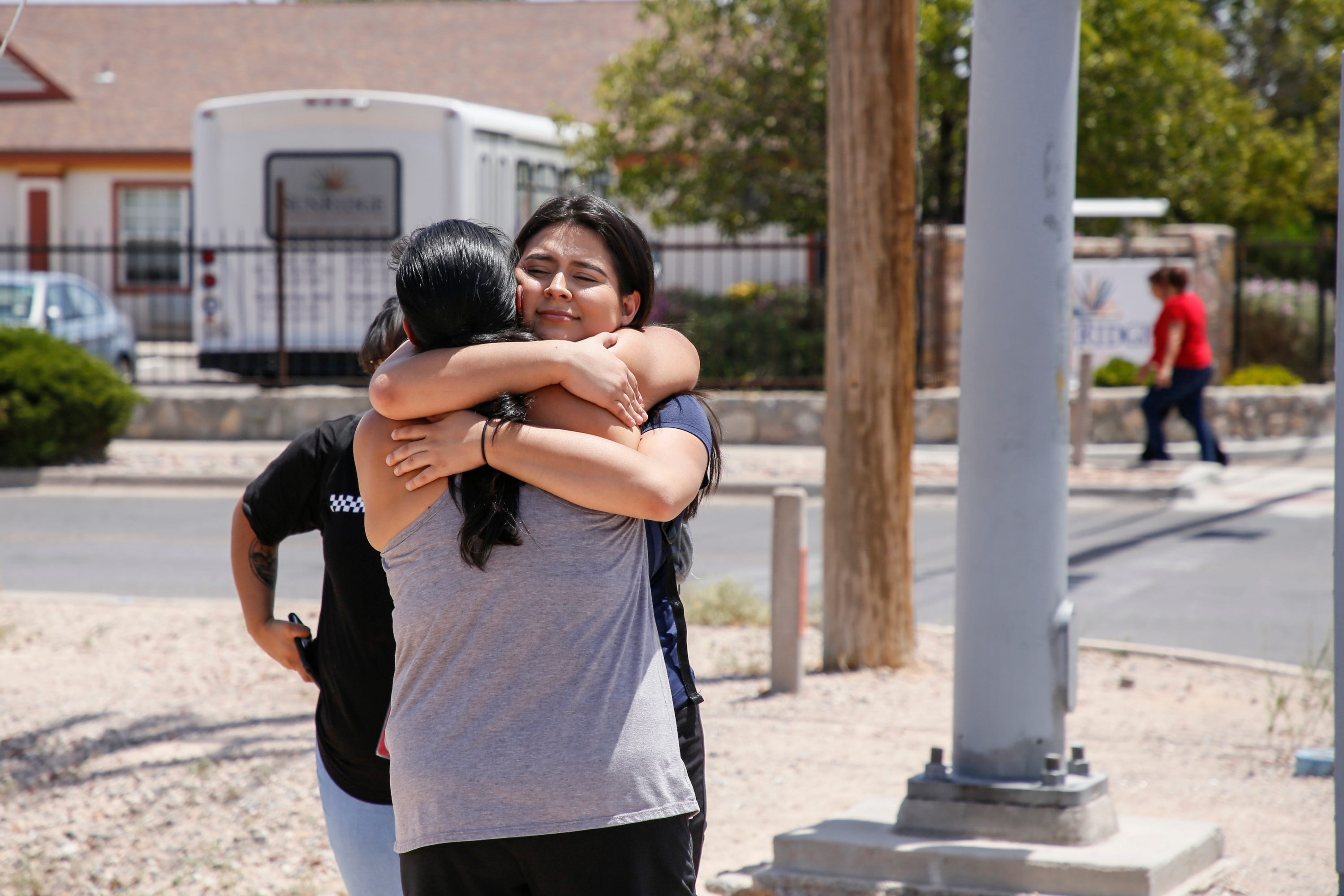 Tabitha Estrada, 19, hugs her mother Rebeca Rivas, 40, an hour after being trapped in a Walmart in El Paso during a mass shooting on Saturday, Aug. 3, 2019.