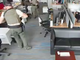 A screengrab captured from an employee's webcam shows police searching the second floor of the Gannett offices on Wednesday, Aug. 7, 2019.