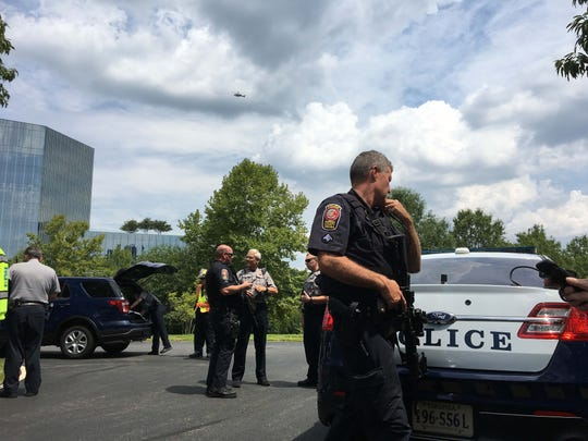 USA TODAY headquarters were evacuated after police reported a man with a weapon at the building in suburban Washington, DC. Authorities said the incident turned out to be a mistaken report of a person with a weapon.