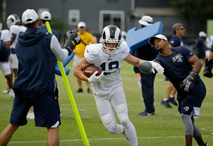 Aug. 7: Los Angeles Rams wide receiver Cooper Kupp runs through a drill during training camp in Napa, Calif. Both the Oakland Raiders and the Los Angeles Rams held a joint practice before their upcoming preseason game.
