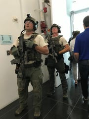 Police in tactical gear at the Gannett headquarters in McLean, Virginia, on Aug. 7, 2019.