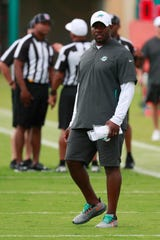 Miami Dolphins head coach Brian Flores watches players run drills at the teams NFL football training camp, Thursday, Aug. 1, 2019 in Davie, Fla.