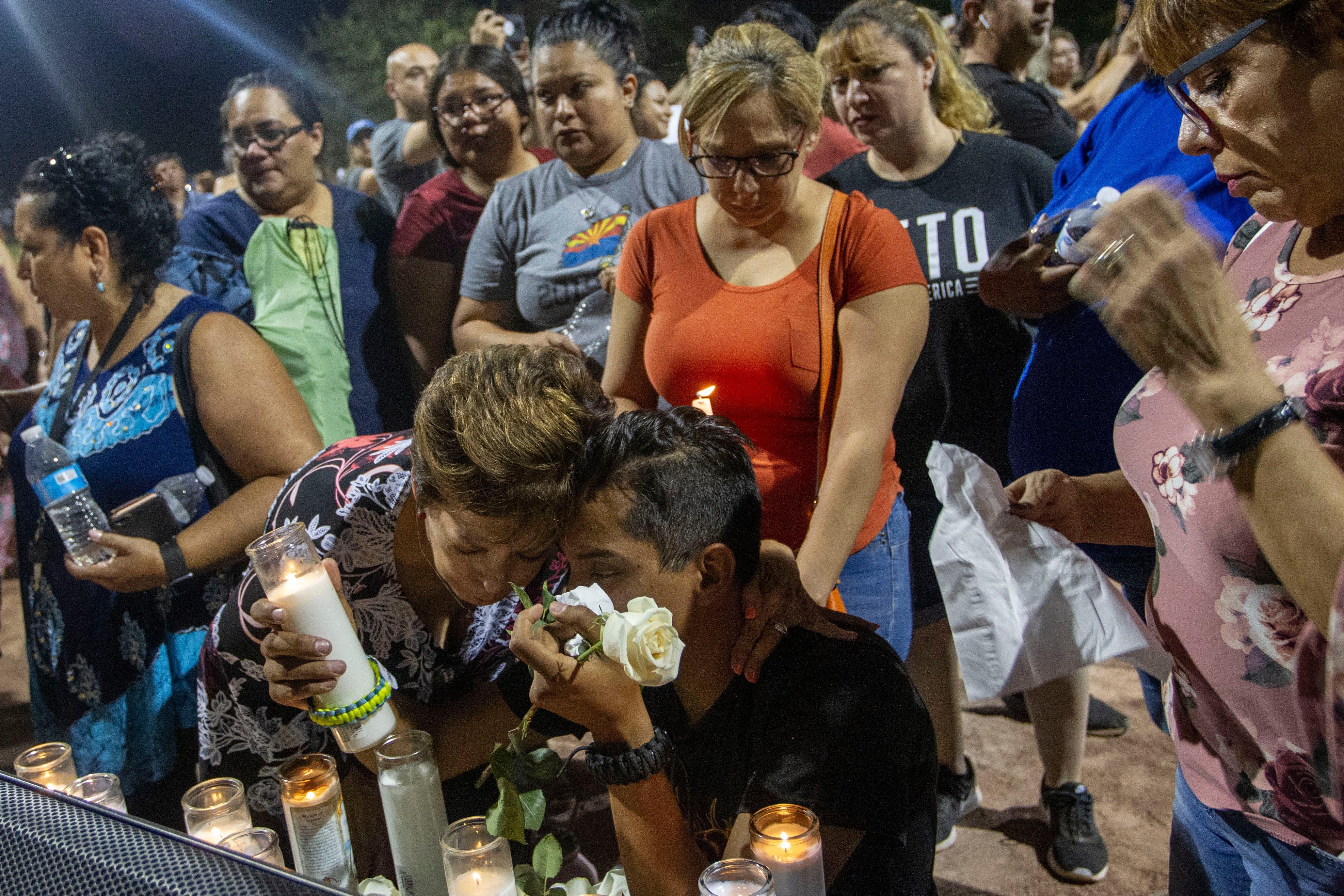 Manuel Diaz mourns the loss of his cousin, Armis Ramirez, 15, during a vigil Sunday, Aug. 4, 2019, at Ponder Park in El Paso.