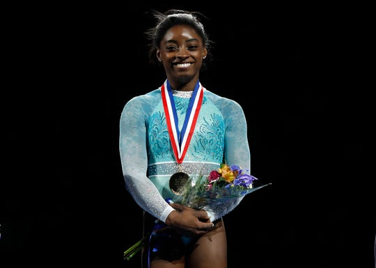 Simone Biles smiles at the 2018 U.S. Gymnastics Championships.