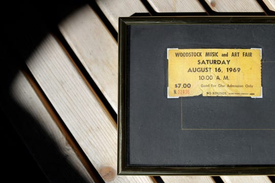 Tom Truesdell has his Woodstock tickets framed. His mother found them in his jeans shortly after the event and secretly held on to them for about 40 years.