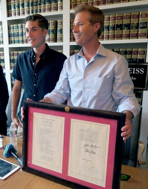On the 5th Anniversary of its signing, David Goldman is joined by his son Sean as he holds a copy of the Sean and David Goldman International Child Abduction Prevention and Return Act during a news conference in Red Bank Thursday, August 8, 2019.