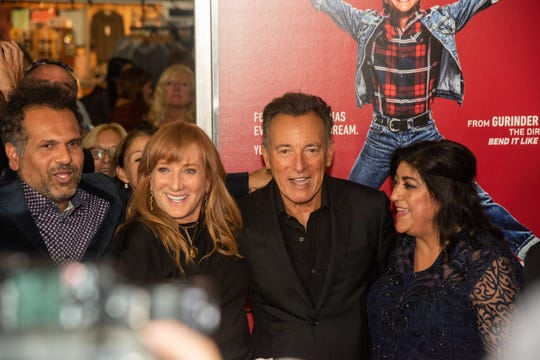 "Premiere of ""Blinded by the Light"" at the Paramount Theatre, Asbury Park. L-R Screenwriter Sarfraz Manzoor, Patti Scialfa, Bruce Springsteen and writer, director, producer Gurinder Chadha on the red carpet. Photo/James J. Connolly/Correspondent."