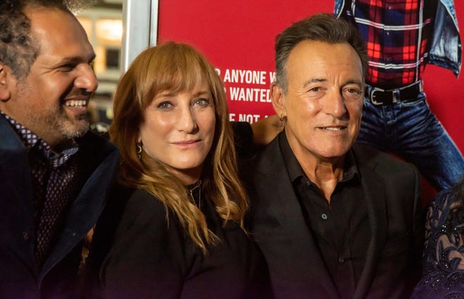 """Patti Scialfa and Bruce Springsteen, with Safraz Manzoor, at the premiere of """"Blinded by the Light"""" at the Paramount Theatre in Asbury Park in the summer of 2019."""