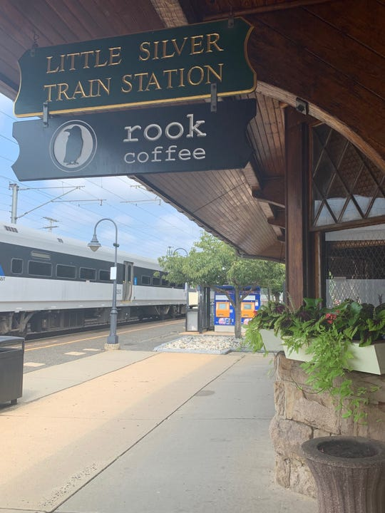A New Jersey Transit train rolls through Little Silver Train Station, which is home to Rook Coffee.