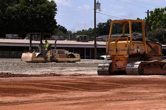 A construction worker drives a roller at Austin Elementary School Thursday. The new school will be built on the site of the old school's track.