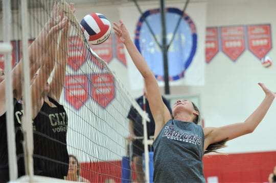 Hawley senior Caitlin Crow, right, makes a play at the net in a scrimmage against Clyde on Monday, Aug. 5, 2019, at Cooper High School in Abilene.